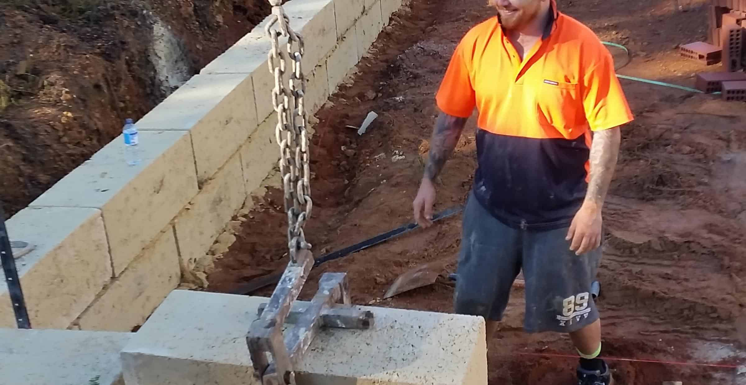 Friendly limestone wall builder at work | Limestone Walls Perth